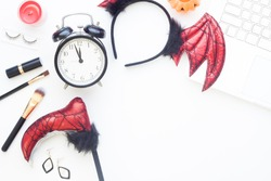 Halloween accessories and cosmetic for girl with laptop on white background, Top view lifestyle and holiday