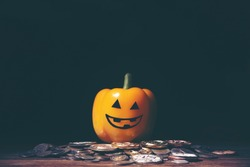 Halloween and business concept with money