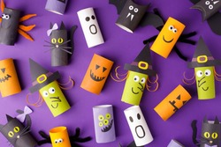 Halloween and decoration concept - monsters from toilet paper roll tube. Simple easy diy creative idea. Eco-friendly reuse recycle decor, kindergarten paper craft, seasonal holiday banner, flyer