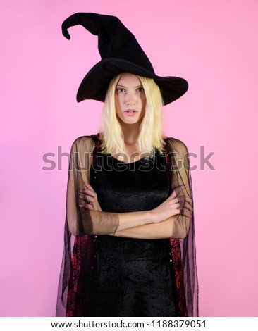 Halloween&autumn holiday concept. Woman in black witch hat, dress and serious face. Witch costume. Witch hat. Costume for party. Beautiful witch in black dress. Halloween horror theme. Trick or treat. #1188379051