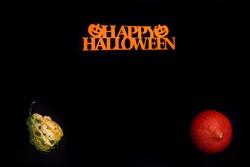 Halloween background. Halloween decorations, pumpkin, black background. Happy Halloween!