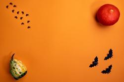 Halloween background. Halloween decorations, spiders, bats, pumpkin, orange background. Happy Halloween!