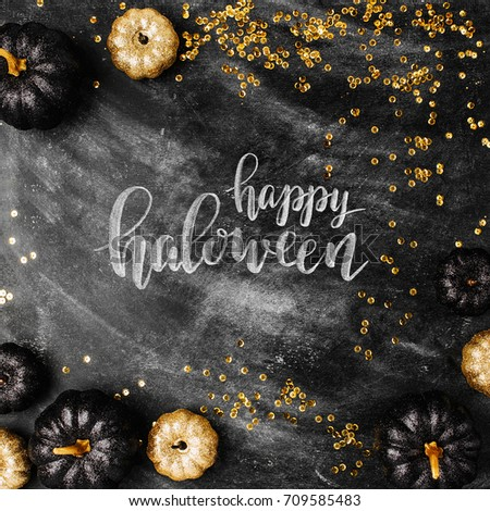 Halloween background with black and gold pumpkins.