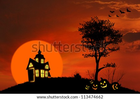 Halloween background with spooky house and pumpkins on the hill