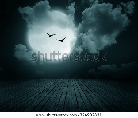 Halloween background, Wooden floor with branch and blurred full moon, Dark style.