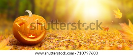 Halloween banner with a pumpkin #710797600