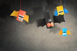 Halloween bat family for Halloween concept background. Paper crafts / DIY.