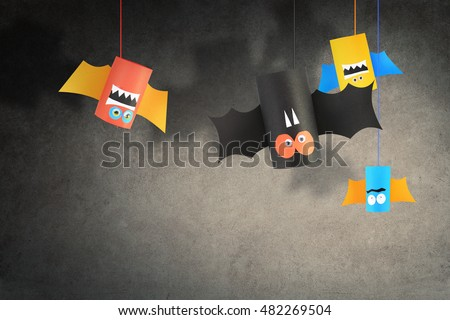 Stock Photo Halloween bat family for Halloween concept background. Paper crafts / DIY.