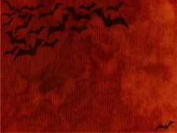 halloween bats black orange sky background