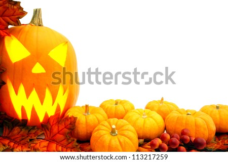 Halloween border with jack-o-lantern, pumpkins and autumn leaves over white