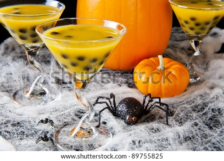 Halloween bubble tea with cobwebs, spiders and pumpkins