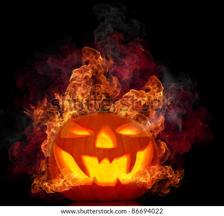 Halloween burning pumpkin on black background