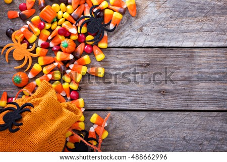 Halloween candy copy space with candycorn and spiders