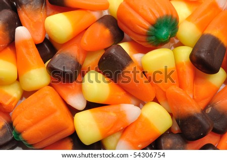 Halloween Candy Corn and Pumpkins for a Background