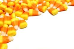 Halloween candy corn corner border over white