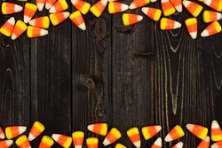 Halloween candy corn double border on an old dark wood background