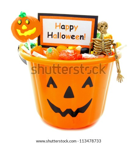 Halloween candy holder full of candy with Happy Halloween tag over white