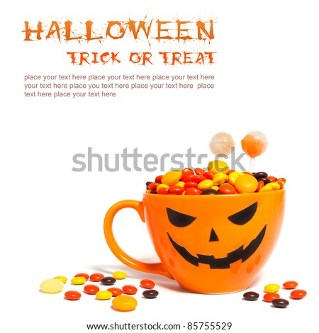 Halloween candy in orange cup with face
