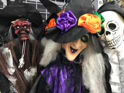 Halloween characters ghosts and witches, all scary creatures stored in the shop and ready for the holiday. Fairy hats, white skulls, teething teeth, corpses, ribs and other fun.