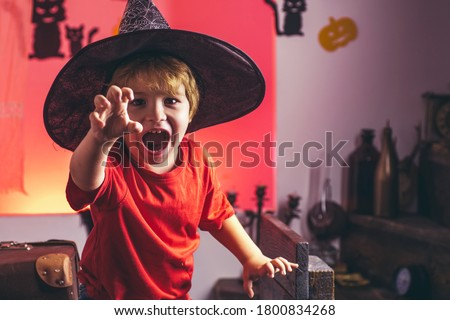 Halloween child. Kids scary Hallowen concept. Kid horror faces. Expression face - surprised cute boy Stock photo ©