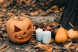 Halloween composition with pumpkins and candles