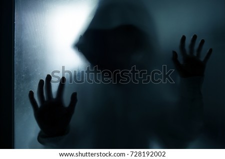 halloween concept, blur of murderer in house