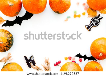 Halloween concept, halloween mood. Pumpkins and cute figures of halloween evils. Skeleton, bats. white background top view copy space #1198292887