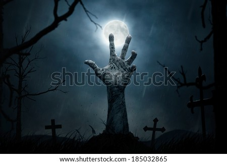 Halloween concept, zombie hand rising out from the ground #185032865