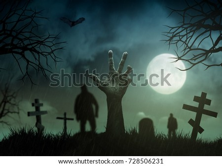 Halloween concept, zombie hand rising out from the ground on  cemetery #728506231