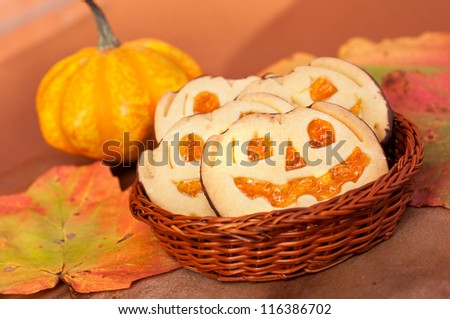Halloween  cookies with pumpkin and autumn leaves