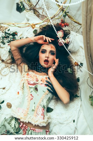 Halloween costume.Brutal diva surrounded by thickets of looking into the camera.Luxury girl in the image of the witch.fashionable toning.creative colors.The girl in the arms of the hands of a monster #330425912