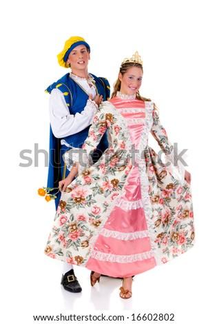 Halloween costume, Cinderella wearing gown, prince behind her. Studio, white background.