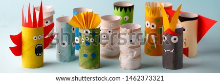 Halloween crafts, paper ghost, monsters on blue paper background with copy space for text. halloween concept handcraft, diy, creative idea from toilet tube, recycle