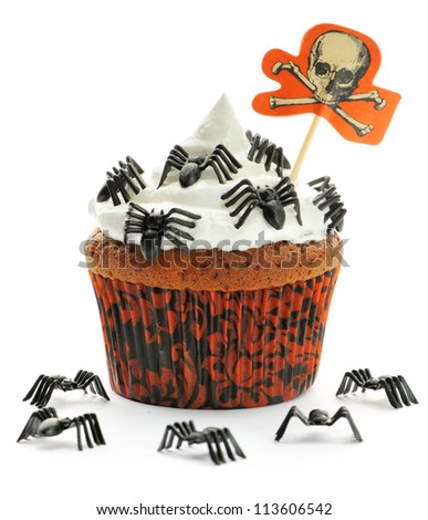 Halloween cupcake with whipped cream and decoration isolated on white