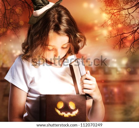 Halloween Cute Little Witch Opening a Box