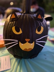 Halloween decorated pumpkin cat face