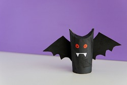 Halloween decoration, vampire bat made from toilet paper roll, easy crafts for kids.