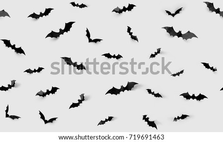 halloween decorations concept - seamless pattern with black paper bats on grey background