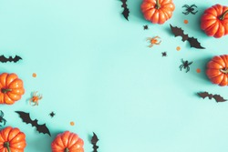 Halloween decorations on blue background. Halloween concept. Flat lay, top view, copy space