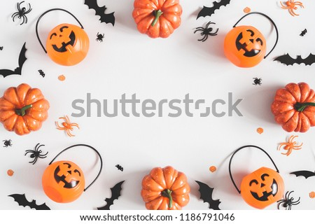 Halloween decorations on pastel gray background. Halloween concept. Flat lay, top view, copy space #1186791046