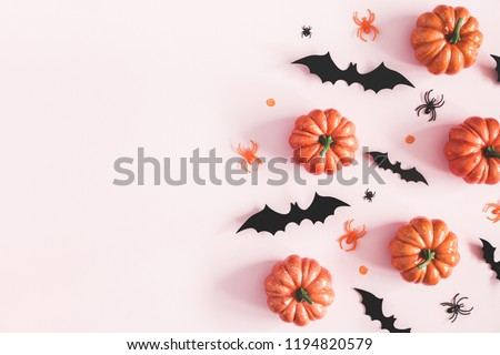 Halloween decorations on pastel pink background. Halloween concept. Flat lay, top view, copy space