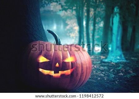 Halloween design - Forest pumpkins. Horror background with autumn valley with woods, spooky tree, pumpkins and spider web. Space for your Halloween holiday text. #1198412572