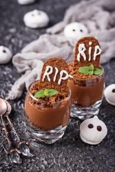 Halloween dessert in shape of grave. Selective focus