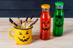 Halloween drinks and chocolate dipped pretzels for Halloween