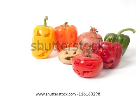 Halloween faces carved into vegetables such as potato, tomato, onion and capsicum instead of pumpkin forming special jack o lanterns.