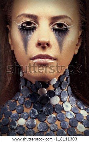Halloween. Fancy dress party. Fantasy. Young woman - bright blue make up