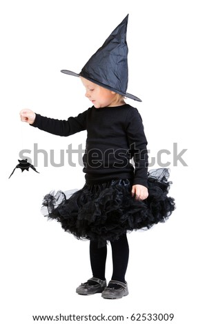 Halloween full body portrait of adorable little witch holding small bat