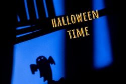 Halloween ghost on blue, window shadow. Halloween time lettering, festive concept.