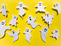 Halloween Ghosts On Yellow Color Background, Halloween Concept Stock Photo