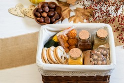 Halloween gif box with spices, biscuits, nuts and pumpkin. Eco friendly gift basket for holiday, top view, flat lay.